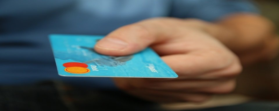 Someone holding a debit card